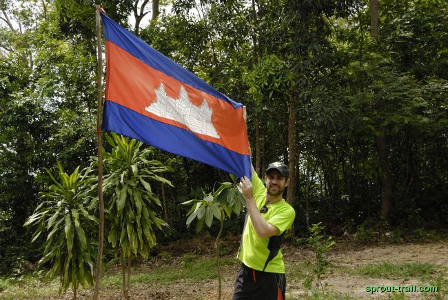 Keith displaying the current flag of Cambodia (which was usurped by the Khmer Republic